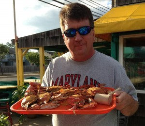 Andy Johnson holding a tray of crab
