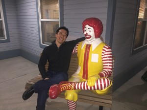 Edward Estipona sits with Ronald McDonald